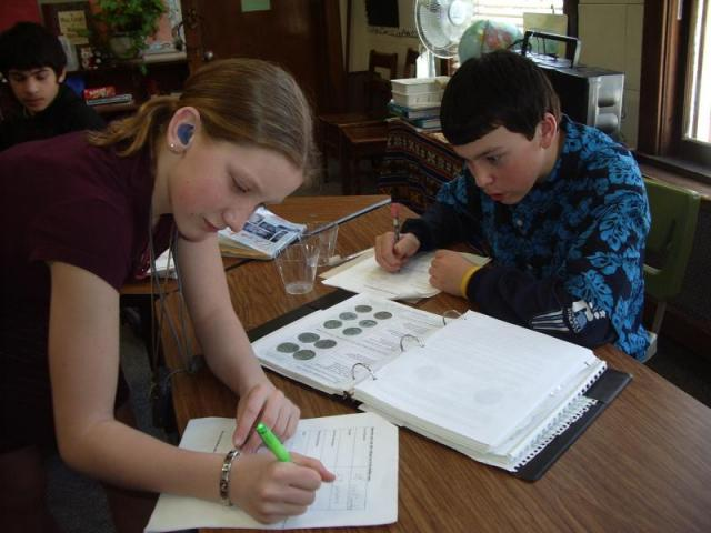 Teacher Kelly's students examine file in MA