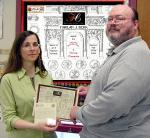 "Nicole Diamente receiving the HJB "" Eruditionis"" award  from Scott Uhrick 2006"