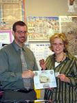 ACCG member, Ken  Baumheckel, presents prize to teacher Kimberly Kemtes in Los Angeles.